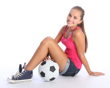 A Teenage Girl Sitting Next To Soccer Ball On White Background